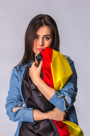 dole: Flag of Germany in hands of sad beautiful woman.