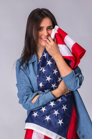 dole: Flag of United States of America in hands of happy beautiful woman.