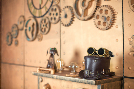 steampunk goggles: Steampunk interier. Hat, goggles, manometer, lamps. Stock Photo
