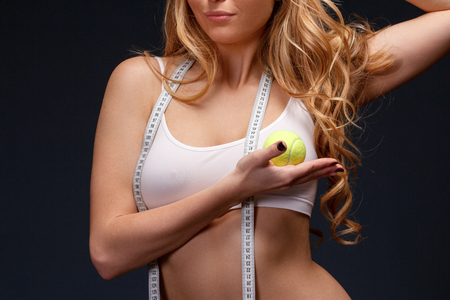 metro medir: Measuring meter tape in woman hands. Diet and fitness concept healthy lifestyle. Foto de archivo