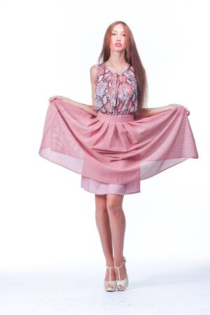 Young beautiful Woman In Pink Romantic Dress Stock Photo
