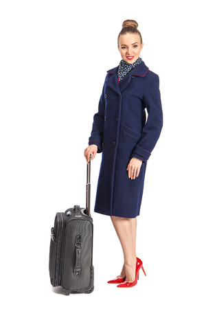 Beautiful happy flight attendant against white background.