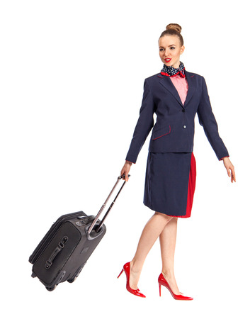 Beautiful happy flight attendant against white background.