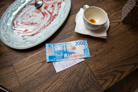 New 2000 russian rubles banknote on the table on cafe.