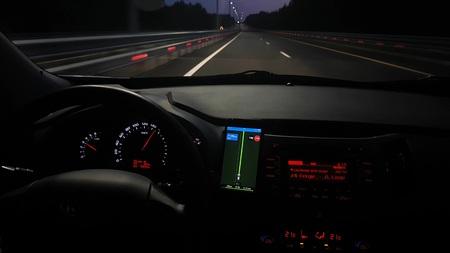 Night traffic with modern car dashboard Standard-Bild