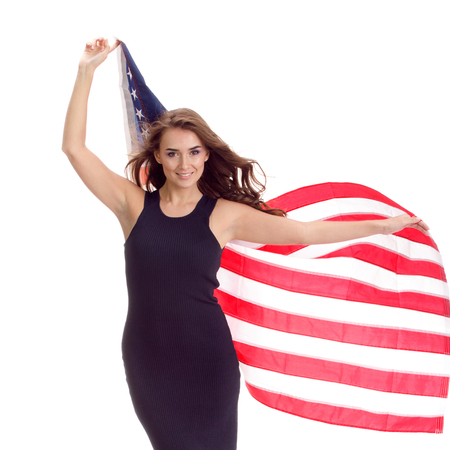 Happy blond young woman holding USA flag. Image isolated on white background