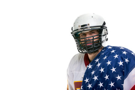 Bearded American football player in helmet with national flag, close up portrait.