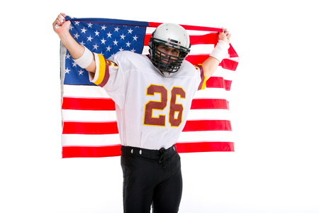Bearded American football player hold national flag, close up portrait. Stock Photo