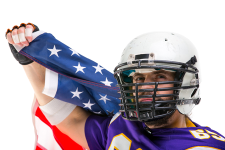 Bearded American football player with national flag, close up portrait.