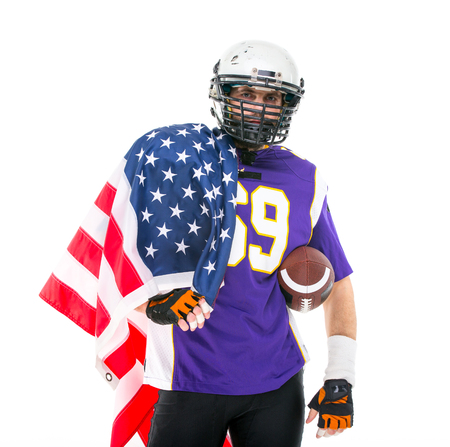 Patriotic American football player with national flag, close up portrait.
