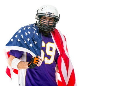 American football player celebrates winning with american flagIsolated on white.