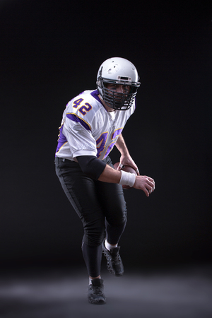 American Football Player posing in studio Stock Photo