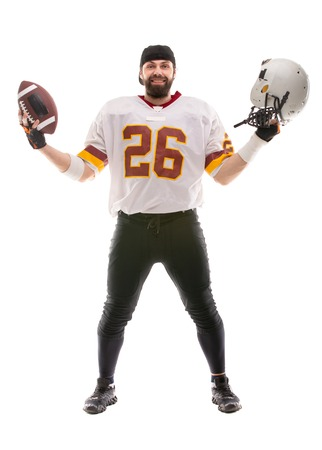 Bearded American football player posing in white uniform