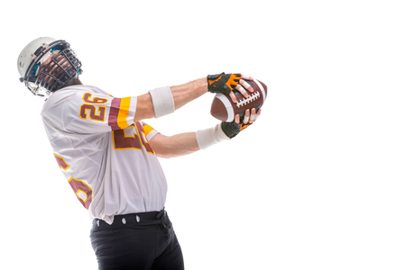 Bearded American football player in white uniform, in action, isolated on white background. Stock Photo