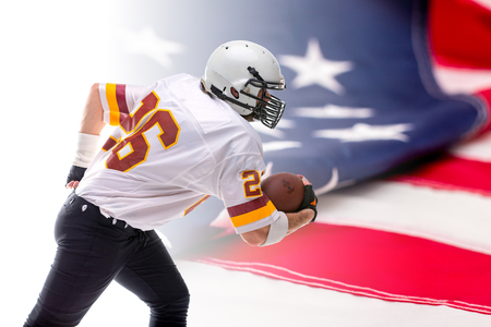 Bearded American football player in white uniform, in action, isolated on US flag background.