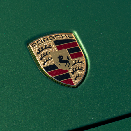 Porsche Logo On Green Cars Hood Close Up View Sep 26 2018 Stock Photo Picture And Royalty Free Image Image 124659593