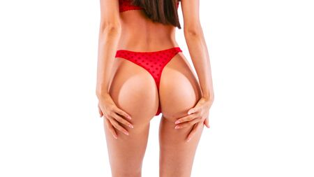 Sexy beautiful woman in red lace panties. Isolated on white.