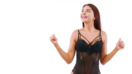 Joyful girl in lacy lingerie shows OK signal by her fingers. Isolated on white. Stockfoto