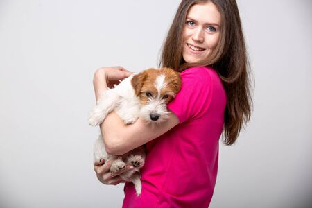 Small bearded jack russell terrier puppy with her owner. Stock fotó