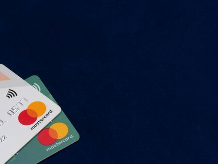 Credit Master Card Close-Up view on blue background. 20 JAN 2020 New York, USA