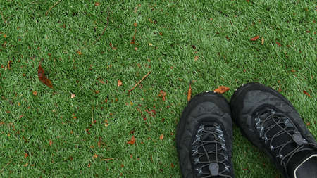 Tourist boots on the grass summer time.