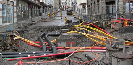 Repair of communications in the city. Pipes and cables. Stock fotó