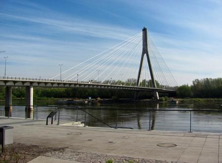 Modern Swietokrzyski bridge in Warsaw over Vistula river,