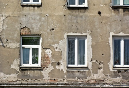 The facade of the house, traces of bullets, the second world war. Warsaw Stock Photo