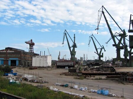 Shipyard cranes in the industrial part of the city Gdansk, Poland Stok Fotoğraf