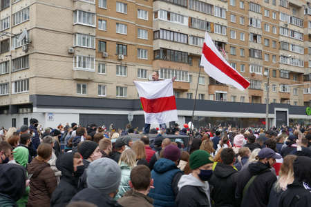 A man stands on the roof of a car. Peaceful demonstration against government violence and electoral fraud in Belarus.