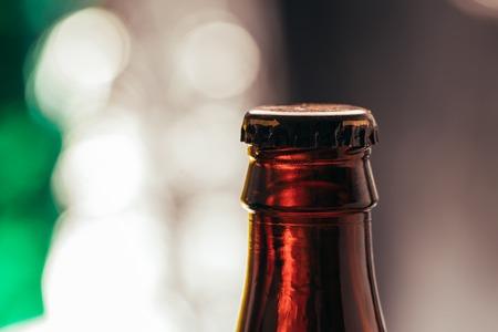 brown beer bottle on a blurred background.