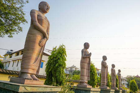 Statues of the first disciples of the Buddha. Bodhgaya, India Stock Photo