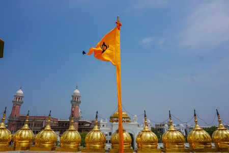 Sikh orange flag flying on the roof of the Golden Temple.