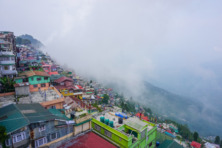 Houses on the mountain. Panorama of the city Darjeeling. Indian himalayas
