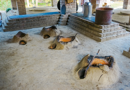 Clay ovens on the floor for cooking. Vedic school Gurukul for boys. Mayapur, India