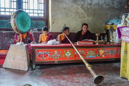 Pelling, Sikkim, India - May 11, 2017: Buddhist children monks conduct prayer services in the temple