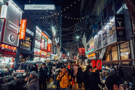 Seoul, South Korea - December 15, 2018: The night streets of Seoul never sleep. In the evening, thousands of different people walk there. Redakční
