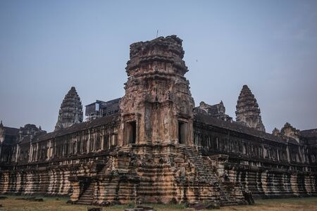 Ancient architecture and ruins of Angkor Wat early in the morning
