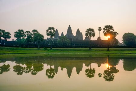 Angkor Wat at sunrise in the reflection of the lake