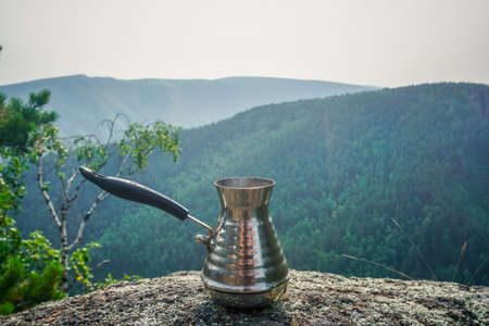 Brewing fresh coffee in a Turk in nature