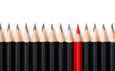 Red pencil standing out from crowd of plenty identical black pencils on white background. Leadership, uniqueness, independence, initiative, strategy, dissent, think different, business success concept