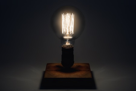 filament: Edison Lamp with filament on a wooden stand. Lighthouse concept.
