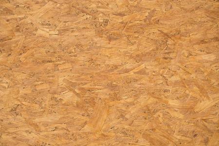 achtergrond en textuur concept - spaanplaat houten natte ondergrond of plank.