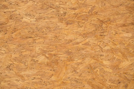 background and texture concept - particleboard wooden wet surface or board. Archivio Fotografico