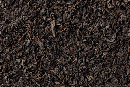 dialect: Black dark textured tea background full frame