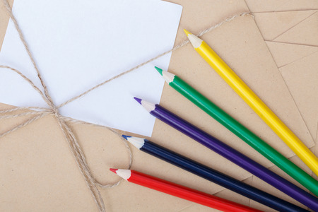 Stationery set for writing and sending letters to relatives. Stylish kraft envelopes for sending congratulatory letters with a holiday. Kraft packaging courier delivery home or to work relatives. Stock Photo