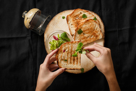 Fried toast with a can of pate on a wooden tray. Eating fried toast with pate for breakfast. Breakfast on the fast hand. Pate spread on toast with salad. Fast food restaurant business concept