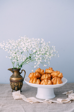 homemade pastries with fillings of potatoes, cabbage and fish, in the composition on a textured background