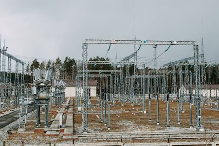 Poles and generator of the power station. A power station that supplies the city with electricity.