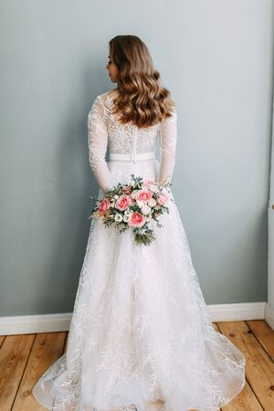 Stylish wedding in European style. Portrait of the bride in the style of fine art, white dress.